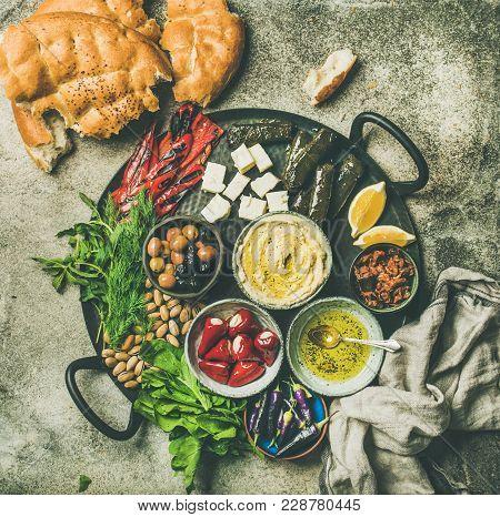 Mediterranean Or Middle Eastern Meze Starters Fingerfood Platter. Flat-lay Of Stuffed Pickled Paprik