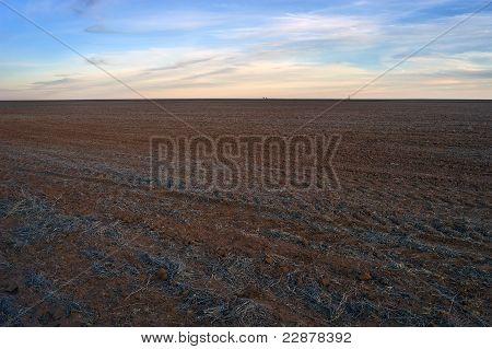 Desolate Farmland at Sunset