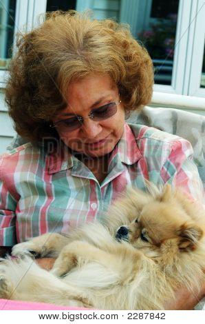 Woman Babying Dog