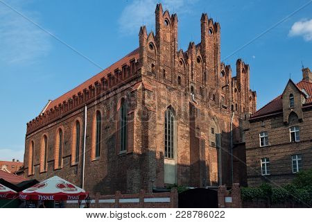 Gdansk, Poland - June 07, 2014: View Of The St. Nicholas Church. Is The Gothic Dominican Church Dati