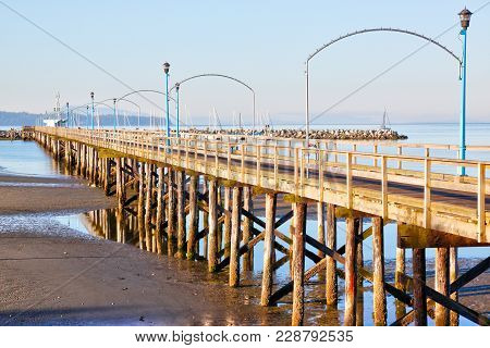 Low Tide At The Famous 1,500 Ft. Long Wooden Pier In White Rock, Bc, Surrounding Semiahmoo Bay Near