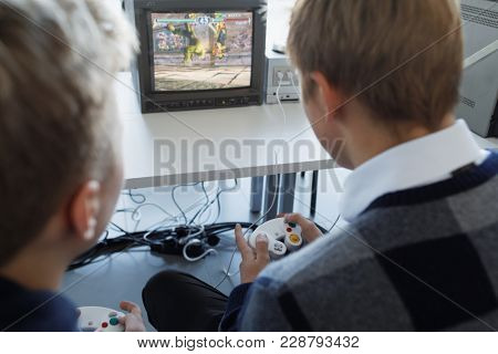 ST. PETERSBURG, RUSSIA - FEBRUARY 22, 2018: People playing with retro video game consoles on the exhibition of retro computers during St. Petersburg Cyber-Sport Festival
