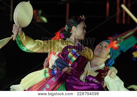 SAINT-PETERSBURG, RUSSIA - FEBRUARY 6, 2018: Dance group Bihua performs the dance with tambourines during the Dance festival of young people of China and Russia. Six choreographic groups take part