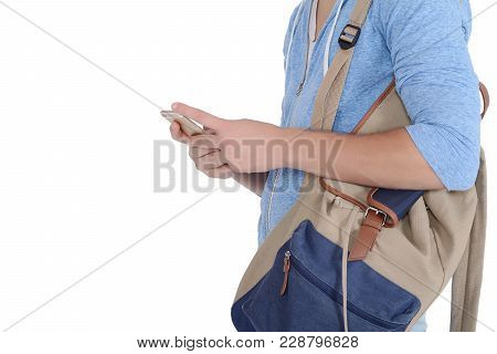 Close Up View Of Young Latin Man With Backpack And Using His Smartphone. Isolated White Background.