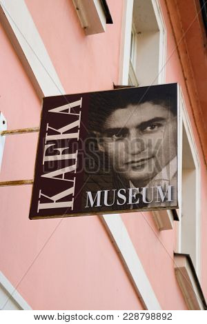 Prague, Czech Republic - October 9, 2017: Name Sign outside the Kafka Museum with a Franz Kafka portrait