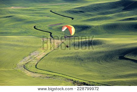 Glider on rolling hills of Palouse ,Washington state