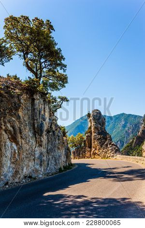 Picturesque and dangerous mountain road in the Provence. The fascinating journey to the canyon in Europe - Verdon. Concept of ecological, extreme and active tourism
