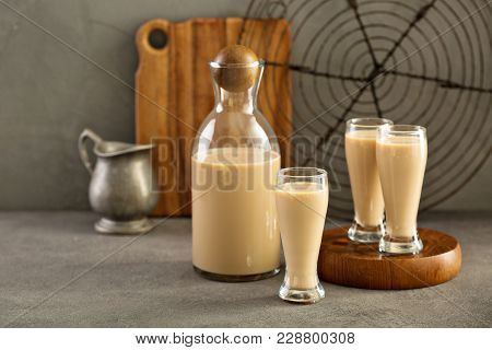 Homemade Irish Cream Liquor In A Bottle And Shot Glasses