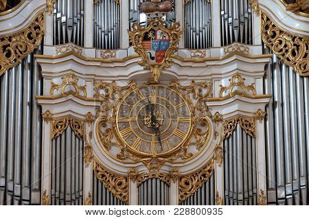 AMORBACH, GERMANY - JULY 08: Clock on the organ in Amorbach Benedictine monastery church in the district of Miltenberg in Lower Franconia in Bavaria, Germany on July 08, 2017.