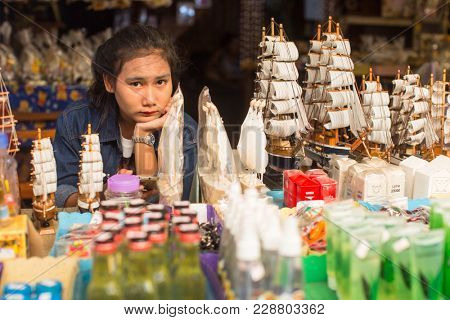 KO CHANG, THAILAND - FEB 18, 2018: Street seller of Bang Bao fishing village, which consists of houses on stilts built into the sea. Ko Chang consisting of 8 villages with 5,356 inhabitants.