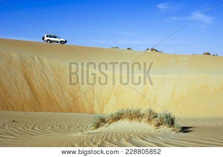 An Suv Car On Top Of A Sand Dune In Rub Al Khali Desert