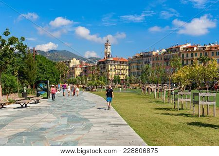 NICE, FRANCE - SEPTEMBER 02, 2015: View of famous Promenade du Paillon - famous 12 hectares urban green park in the center of Nice with paved walkways, kids play areas, green lawns with olive trees.