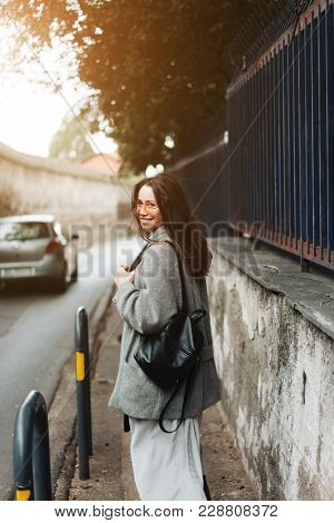 Beautiful Young Girl On A Narrow Street. Girl In The City