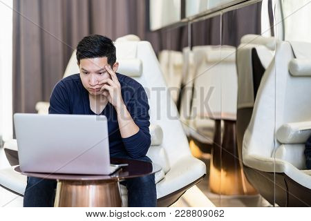 Stressed Out Asian Man Freelancer Looking Computer Laptop And Holding Hand On His Face. Young Asian