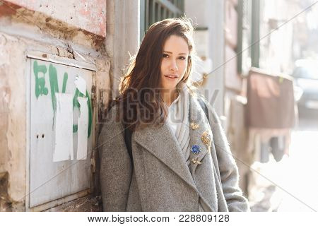 Beautiful Young Woman Walking In The Old Town.