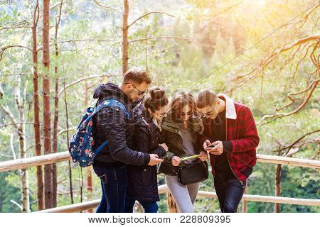 Four Tourists Trying To Find The Way, Discuss It
