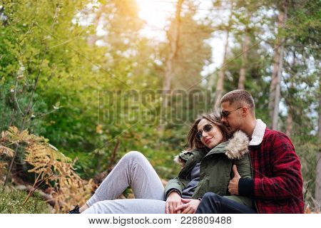 Guy And The Girl Are At Rest In The Woods
