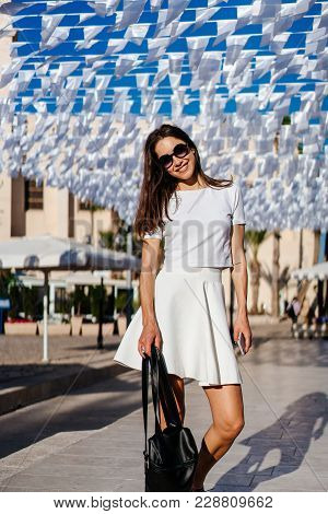 Beautiful Sexy Woman Young Brunette Wear In White Dress And Handbag