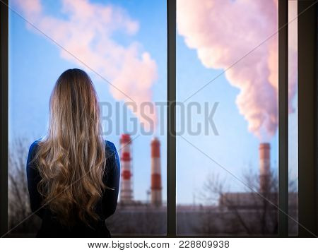 The Girl Looks Through The Window At The District Heating Pipe. Concept - Ecology Of The City, Envir