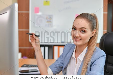 Business Concepts. Beautiful Businesswoman Is Working In Office. Beautiful Young Businesswoman Is Wo
