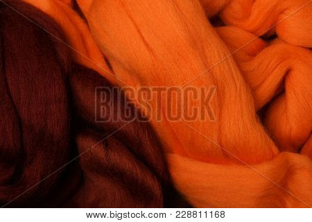 Bright Colored Merino Wool For Felting And Needlework, Hobby. The Stripes Of Burgundy Color And Oran