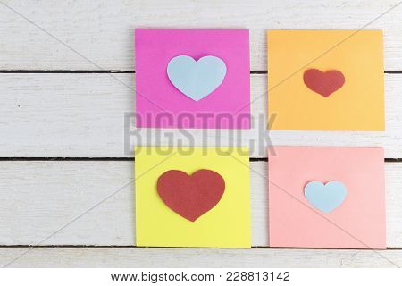 Paper Sticky Notes With Heart Shaped Paper Cut Outs On White Wood