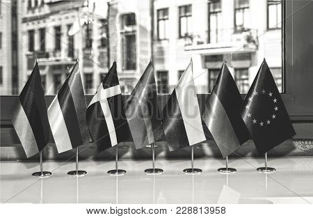 Black And White Photo. Flags Of European Countries And The Flag Of The European Union Close Up At Th