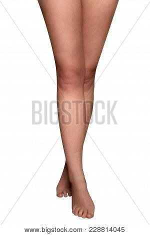 Beautiful Slender Bare Feet Of A Woman. On A White Background.