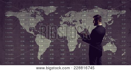 Businessman With Computer Tablet Standing Over Diagram. World Map Background. Business, Globalizatio