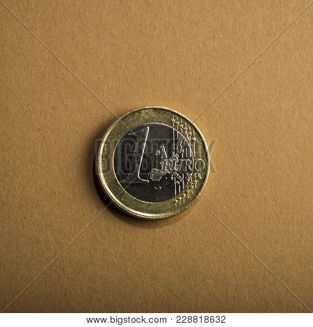 Coin One Euro On A Brown Background. Business Metaphor. Conceptual.