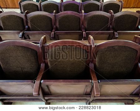 Soft Wooden Chairs In The Auditorium. The Interior In A Public Building.