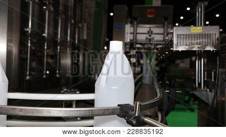 Polyethylene Gallon In Conveyor Labelling Machine ; Food Industry