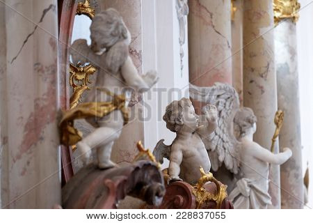 AMORBACH, GERMANY - JULY 08: Angel statues in Amorbach Benedictine monastery church in the district of Miltenberg in Lower Franconia in Bavaria, Germany on July 08, 2017.