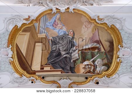AMORBACH, GERMANY - JULY 08: An allegory of art, fresco by Matthaus Gunther in Benedictine monastery church in Amorbach, Germany on July 08, 2017.