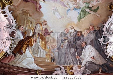 AMORBACH, GERMANY - JULY 08: The death of Saint Benedict, fresco by Matthaus Gunther in Benedictine monastery church in Amorbach, Germany on July 08, 2017.