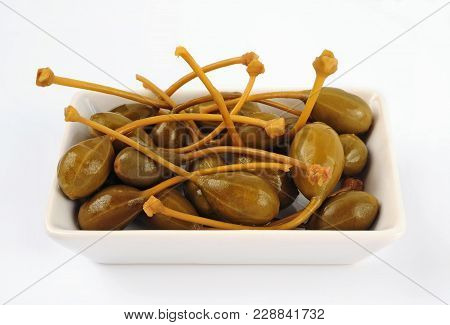 Bowl Of Caper Berries Isolated Over White Background