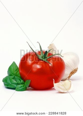 Tomato, Basil And Garlic Isolated Over White Background