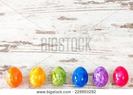 Easter Eggs In Rainbow Colors On Rustic Bright Wooden Background