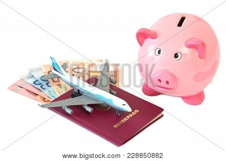 Piggy Bank With Toy Plane, Passport And Money Isolated On White