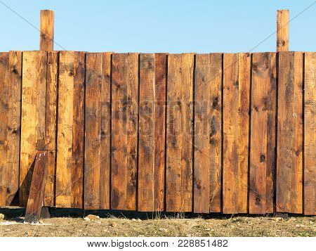 The Texture Of Weathered Wooden Wall. Aged Wooden Plank Fence Of Vertical Flat Boards