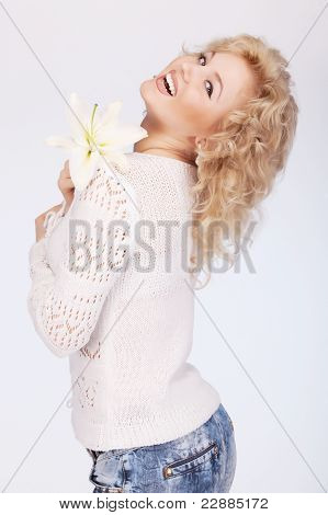 Smiling Young Woman With Flowers