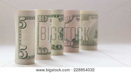 A Roll Of Money, Highlighted On A White Background, A Place For The Text.