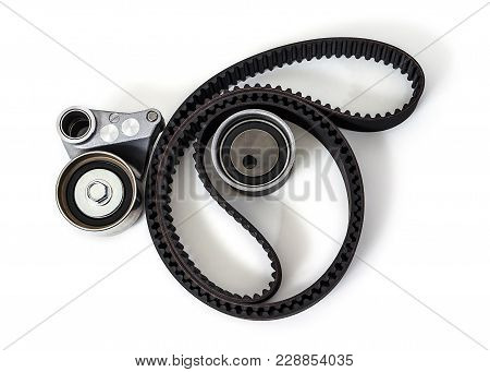 Kit Of Timing Belt With Rollers On A White Background Isolated. Auto Parts. Spare Parts.