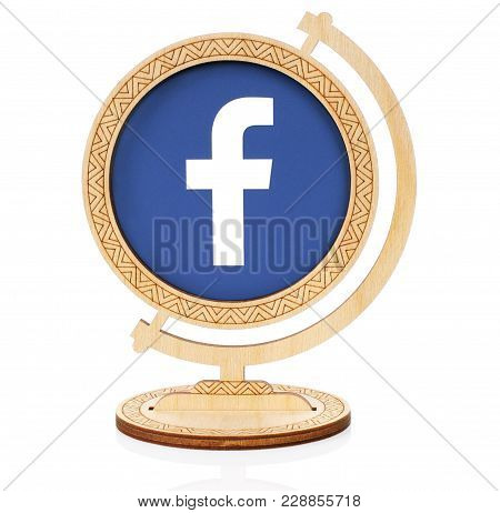 Kiev, Ukraine - November 01, 2017: Facebook Circle Icon Printed On Paper And Placed Into Wooden Glob