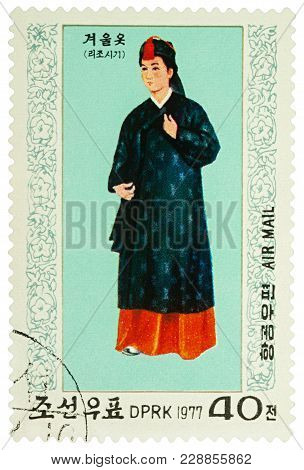 Moscow, Russia - February 28, 2018: A Stamp Printed In Dprk (north Korea), Shows A Woman In Traditio