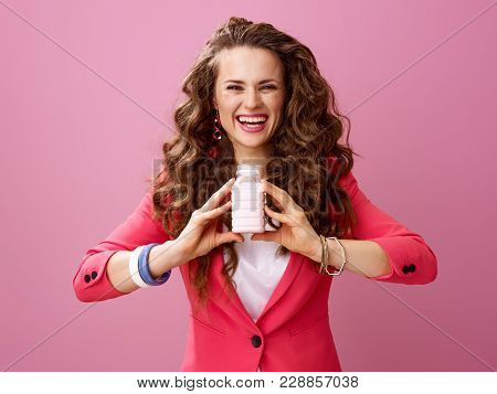 Happy Modern Woman Isolated On Pink Showing Farm Organic Yogurt