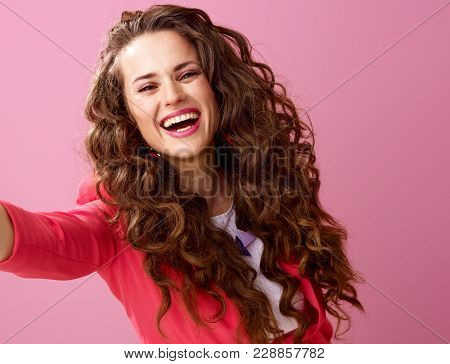 Smiling Trendy Woman Isolated On Pink Taking Selfie