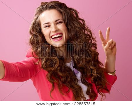 Happy Woman Isolated On Pink Taking Selfie And Showing Victory