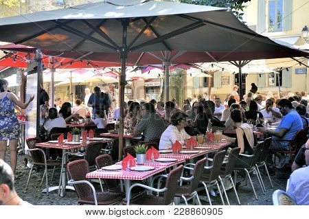 Carcassonne, France - September 5, 2017: Terrace Of Restaurant In A Small Street Of The Fortified Ci
