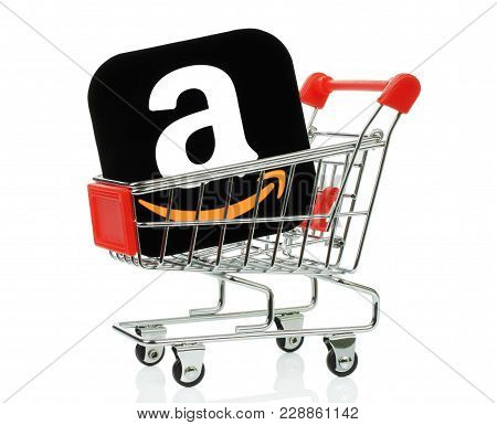 Kiev, Ukraine - November 01, 2017: Amazon Icon Printed On Paper And Placed Into Shopping Cart. Amazo